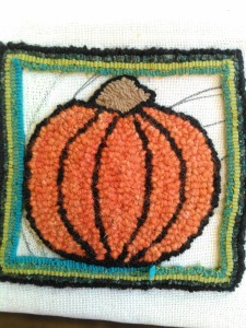 Wool strips, though the pumpkin itself is hooked from llama yarn.